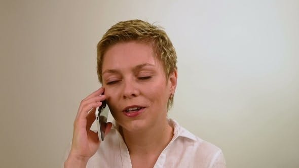 Blond Short Hair Blond Girl Talks By Mobile Phone
