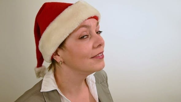 Thumbnail for Pretty Girl In Red Christmas Santa Hat Smiles