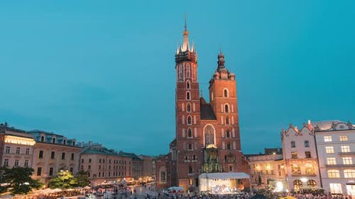 Day to Night Time Lapse of Saint Mary's Church on Main Square in Cracow, Poland