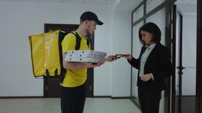 Businesswoman Paying for Food Delivery