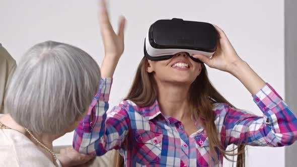 Amazed Young Woman in Virtual Reality Glasses
