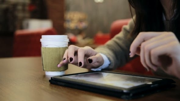 Thumbnail for Woman Hands Using Tablet Touchscreen In Cafe