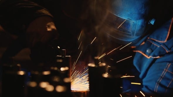 Thumbnail for Hard Labour. Electric Welder At Work. Many Sparks