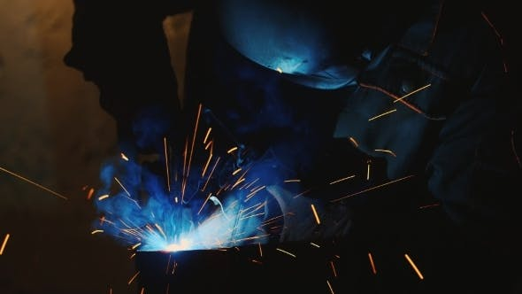 Cover Image for Welder At Work. Many Spectacular Sparks And Molten
