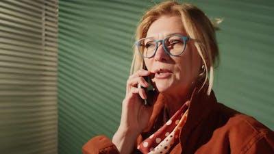 Senior Businesswoman Speaking on Cell Phone