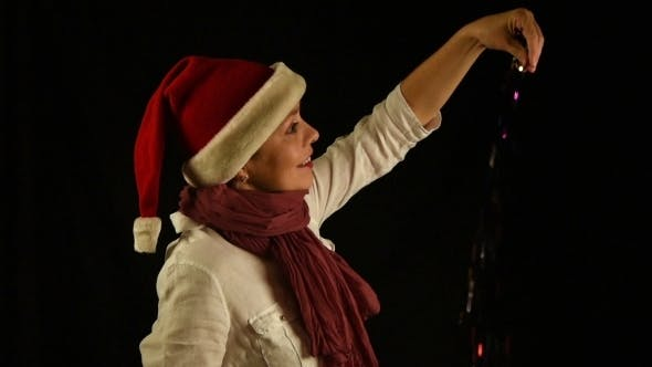 Thumbnail for Young Woman In Red Christmas Santa Pours Confetti