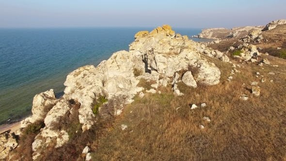 Thumbnail for Flying Above Sea With Rocky And Sand Coast