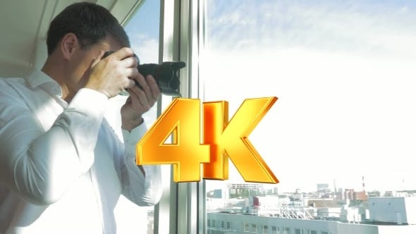 Thumbnail for Man Taking Pictures Of City View