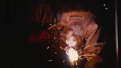 Hard Labour Electric Welder At Work