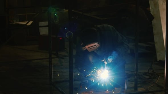 Thumbnail for Work At The Plant. Electric Welder At Work