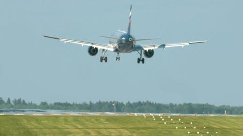 Airplane Landing On Take-off Runway