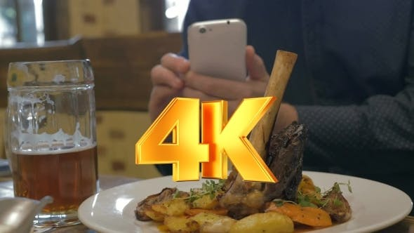 Thumbnail for Man With Phone Making Photo Of a Served Dish
