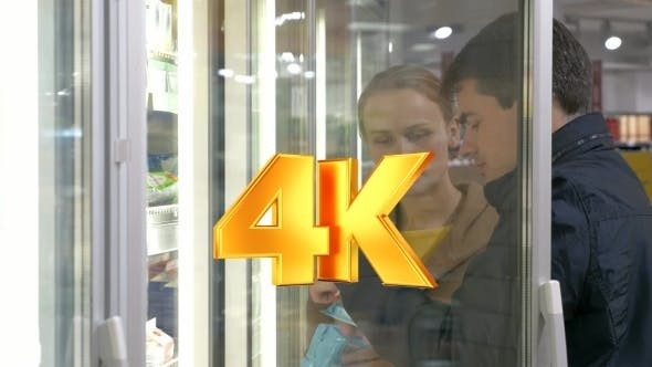 Thumbnail for Young Family Couple Taking Products In Fridge