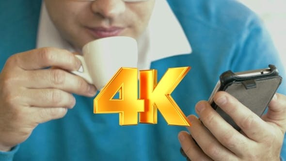 Thumbnail for Adult Man Using Smartphone And Drinking Coffee