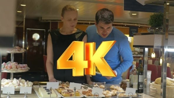 Thumbnail for Man And Woman Looking At Desserts In Cafe