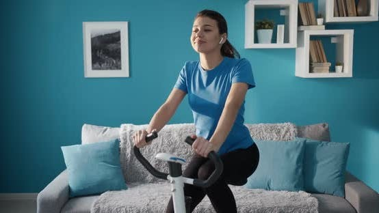 Thumbnail for Active Girl in Sportswear Working Out on Exercise Bike
