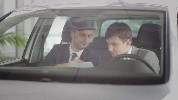 Thumbnail for Two Guys Discussing The Car Specifications