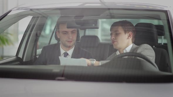 Cover Image for Buyer And The Salesman In The Car