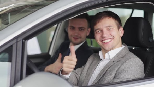 Thumbnail for Smiling Guys Showing Thumbs Up In The Car