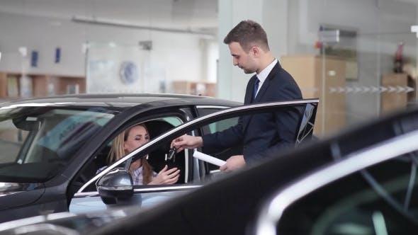 Thumbnail for Dealer Transmitting The Keys Of a New Car