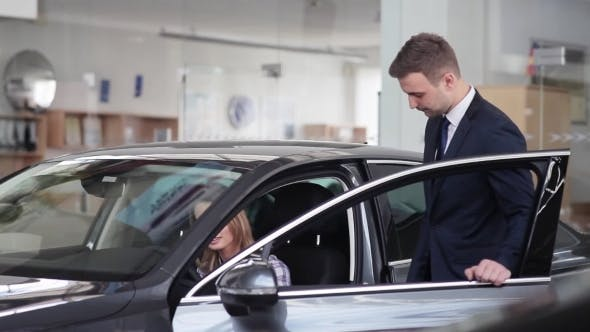 Thumbnail for Salesman Explains To Girl Car Specifications