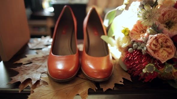 Thumbnail for Bridal Bouquet And Bride's Shoes On Autumn Leaves