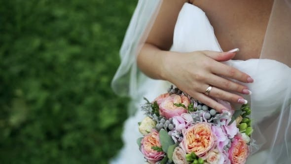 Thumbnail for Bride Holds a Wedding Bouquet In Her Hands