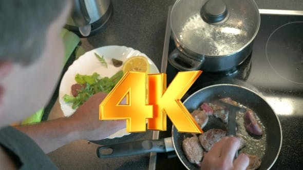 Thumbnail for Man Cooking Tasty Supper At Home