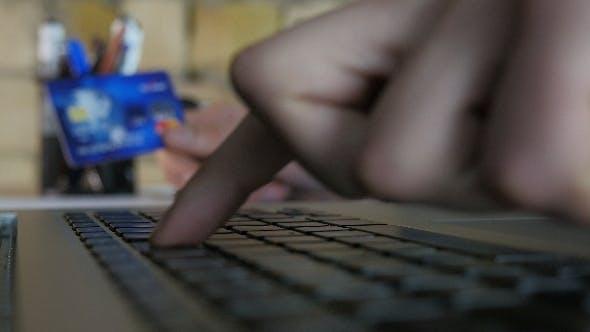 Thumbnail for Man Online Shopping Using Laptop
