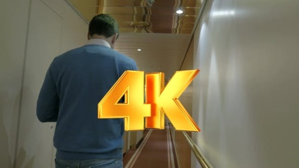 Thumbnail for Adult Man Walking Along A Corridor Of Ocean Cruise