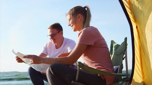 A Young Family is Considering a Camping Map in Order to Navigate a Route