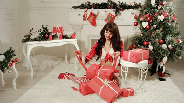 Thumbnail for Sexy Girl In Santa Costume Getting a Gifts