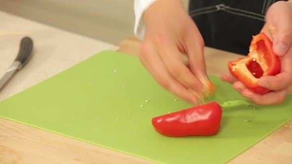 Thumbnail for Cheff Is Cutting Red Paprika On a Cutting Board