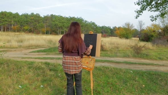 Thumbnail for Woman Painter Creating Autumn Picture At Nature