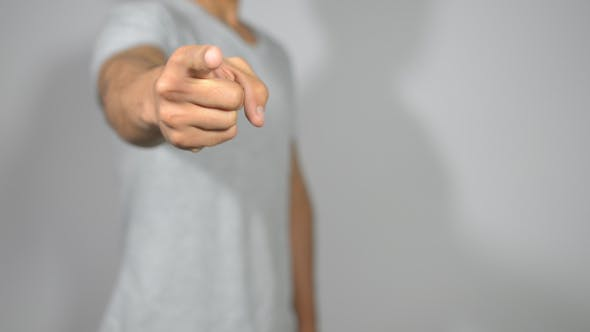 Casual Man Pointing with Finger