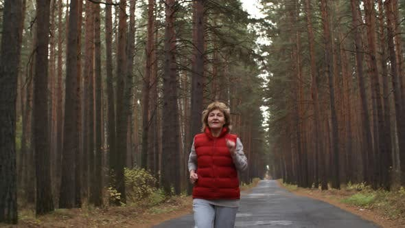 Thumbnail for Retired Active Woman Jogging in Park