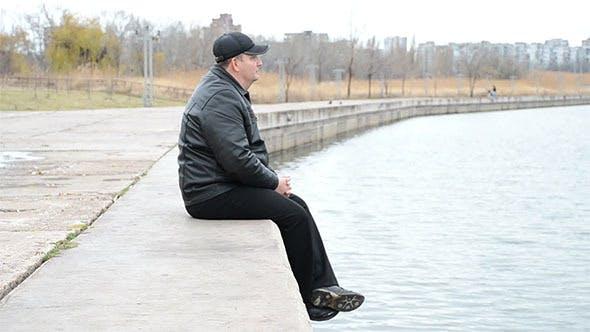 Thumbnail for Man Sitting on Concrete Slabs
