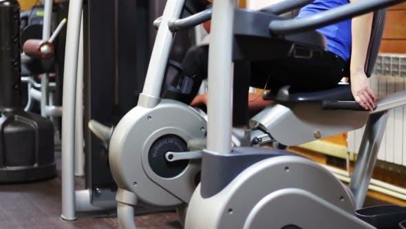 Thumbnail for Girl In a Fitness Room On An Exercise Bike