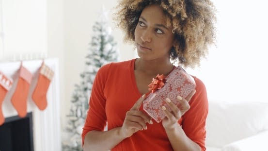 African Woman Holding a Christmas Gift