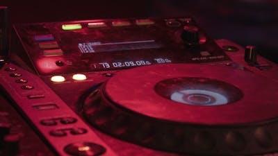 DJ Mixer At Night Club