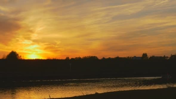 Thumbnail for River Water Flows Bright Yellow Sunset at The