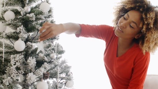 Thumbnail for Pretty Young African Woman Decorating An Xmas Tree