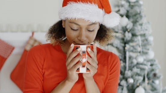 Thumbnail for Young Woman Enjoying Hot Coffee At Christmas