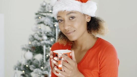 Thumbnail for Young Girl Enjoying Coffee On Christmas Day