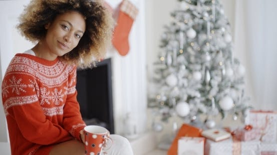 Thumbnail for Smiling Woman Drinking a Mug Of Christmas Coffee