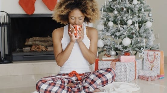 Thumbnail for Blissful Young Woman Drinking Coffee At Christmas