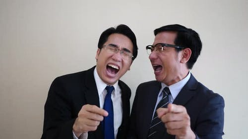 Two businessmen laughing.