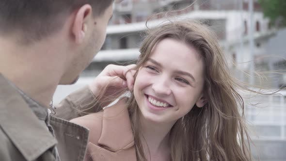Thumbnail for Portrait of Laughing Happy Brunette Girl Dating Outdoors with Boyfriend. Loving Young Caucasian Man