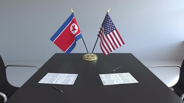 Thumbnail for Flags of North Korea and the United States and Papers on the Table