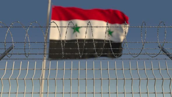 Thumbnail for Blurred Waving Flag of Syria Behind Barbed Wire Fence